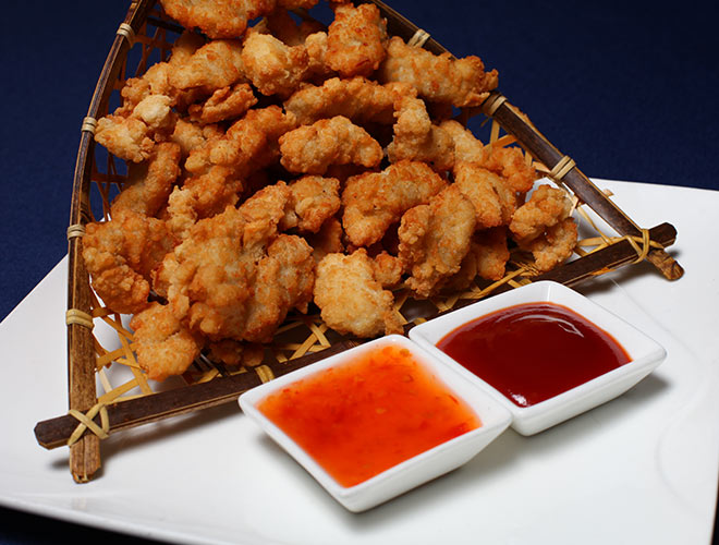 <b>Chicken Popcorn</b><br/>Crunchy deep-fried chicken bites served with ketchup