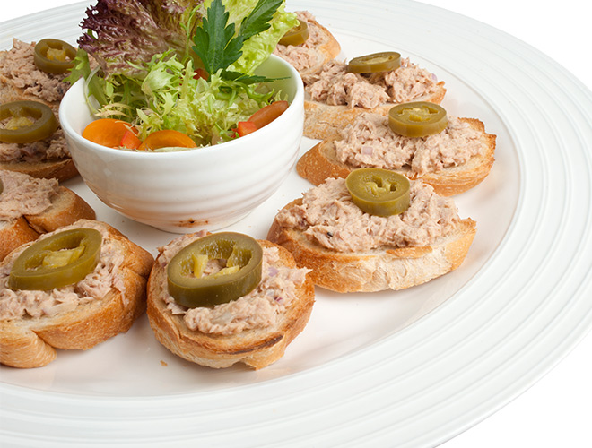 <b>Mexican Tuna Fish Bread</b><br/>Sliced baguettes topped with tuna-mayonnaise and jalapenos