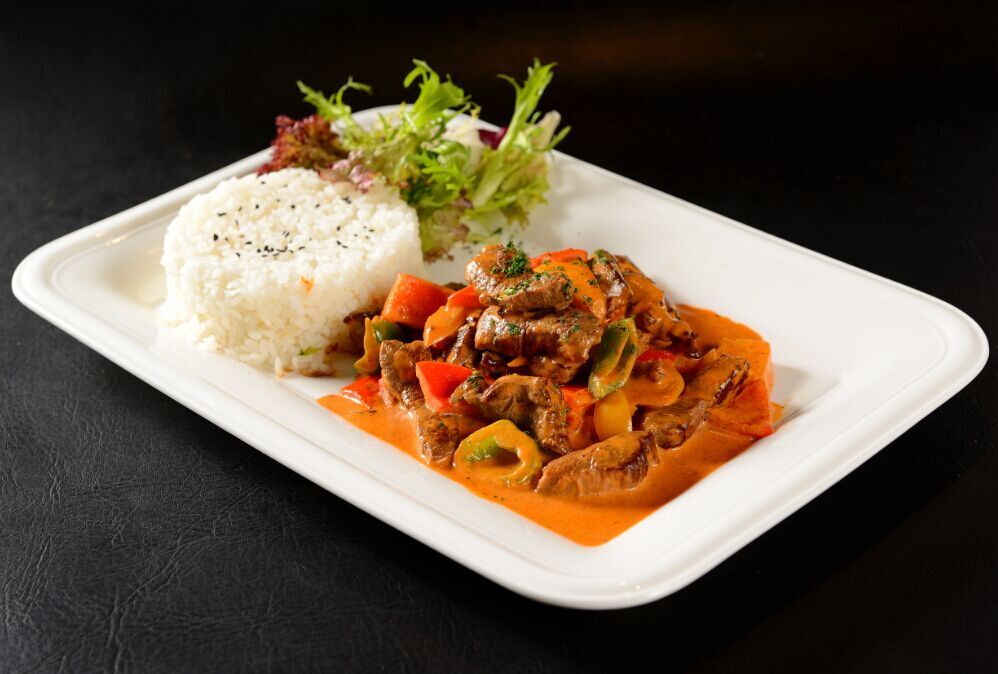 <b>Beef Stroganoff</b><br/>Shredded Beef with Pickles, Mushrooms, Sour