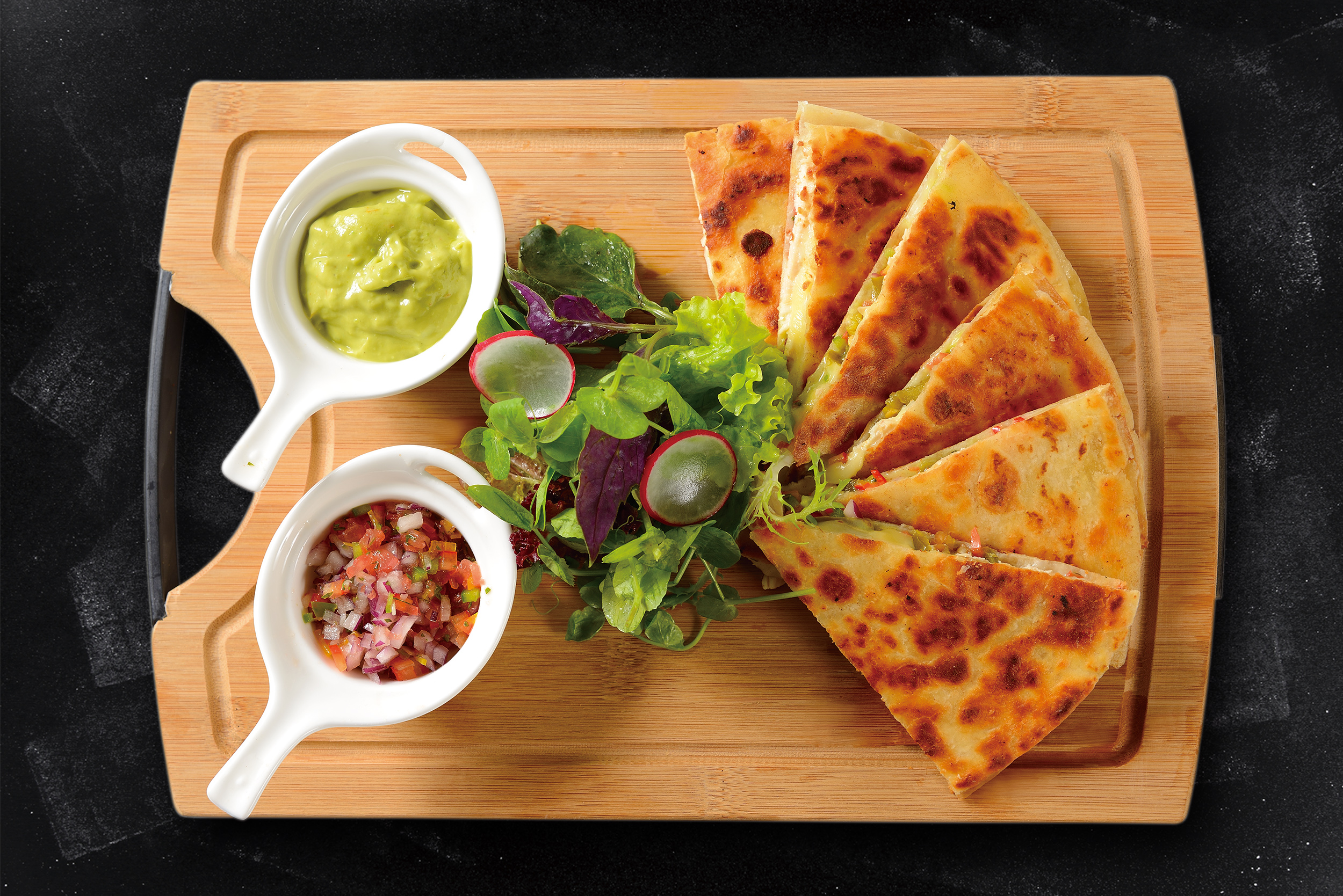 <b>Chicken Quesadillas</b><br/>Two Flour Tortillas stuffed with Mushrooms and