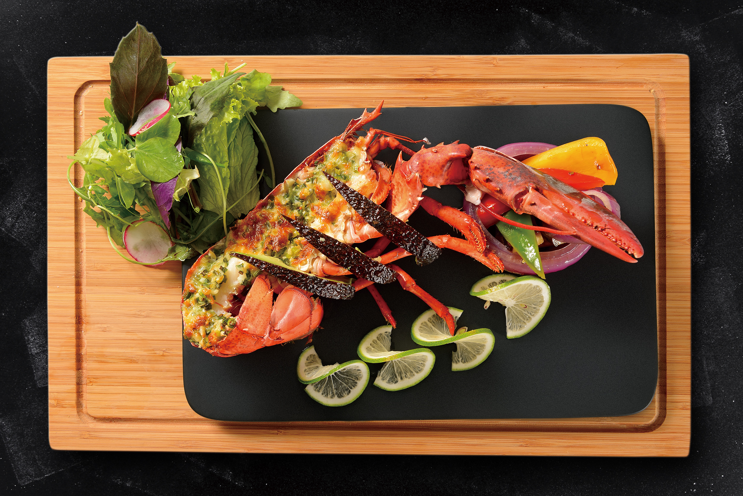 <b>Roasted Boston Lobster with Avocado and Oyster Sauce (Half)</b><br/>A black and green Boston lobster special with tender and delicate meat.