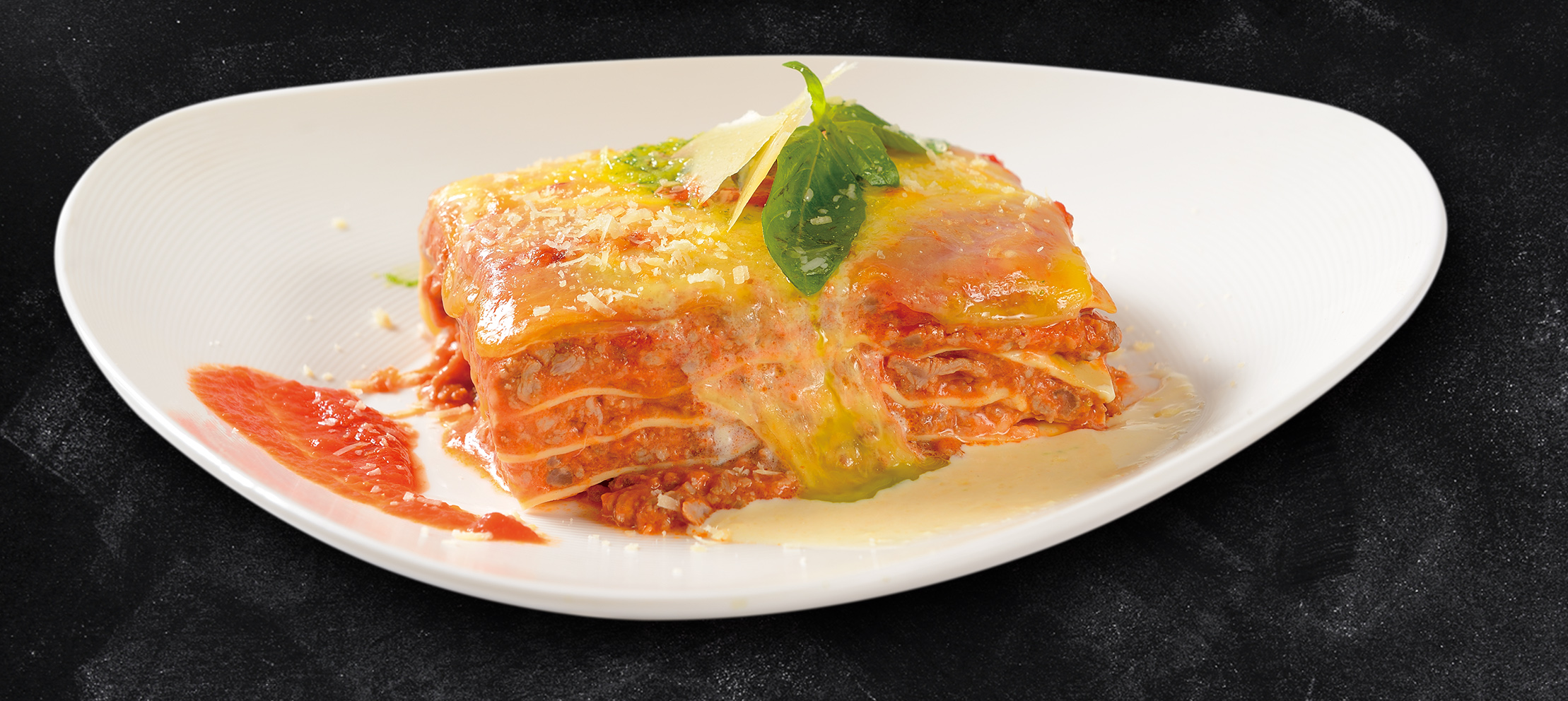 <b>Beef Lasagna Smothered in Meat Sauce and Mozzarella Cheese</b><br/>A northern Italian Favorite! Lasagna layered